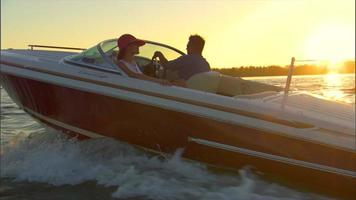 Woman waterskiing at sunset video