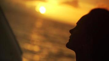 A woman's face in the sunset