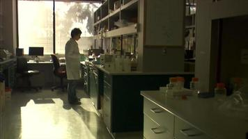 Dolly in on scientist in a lab
