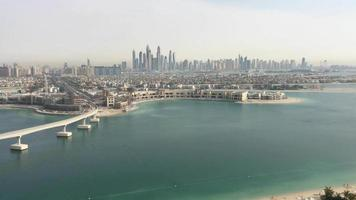 Dubai Beachfront With Downtown Skyline Across The Water 4k video