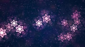 Purple stars snowflakes and particles floating on dark background video