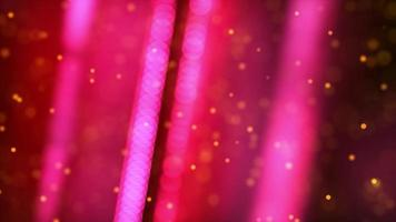 Pink dotted lines spinning and yellow particles floating on dark background video