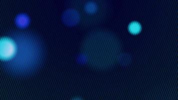 luces azules suaves que flotan lentamente sobre un fondo oscuro y un patrón de líneas en el frente