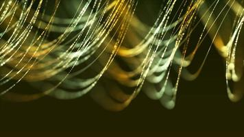 linee sottili verdi e gialle fluttuano nell'aria come capelli su uno sfondo scuro
