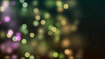 Luces bokeh hexagonales verdes y púrpuras que brillan y se desvanecen sobre fondo oscuro
