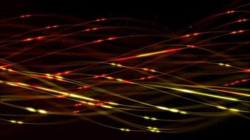 Líneas y partículas brillantes rojas y verdes flotando y girando sobre fondo oscuro