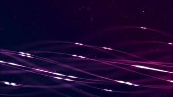 líneas y partículas brillantes de color púrpura flotando y girando sobre un fondo oscuro video