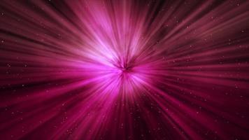kleine Partikel und rosa Lichtstrahlen, die aus der Mitte der 4k-Szene leuchten video