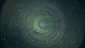 Particles and waves with circle shape undulating on 4K green surface