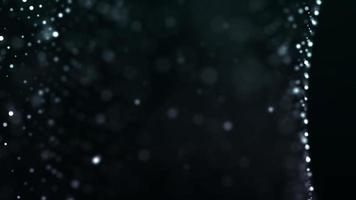Marco de partículas suaves moviéndose en grupos sobre fondo negro 4k video