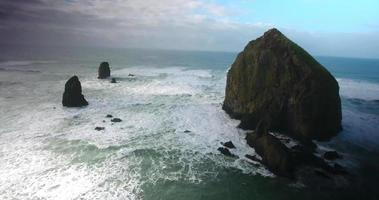 Aerial Drone Shot Panning Out from Haystack Rock in 4K