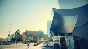 Static shot of outside of the Walt Disney Concert Hall and a bus crosses the scene at Los Angeles 4K. video