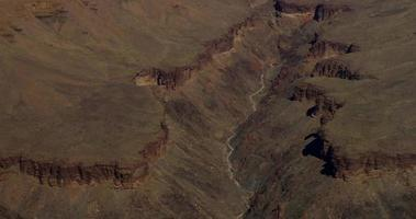 Vertical panning shot of the valleys inside the red canyon in 4K video
