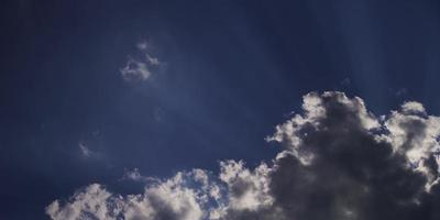 Time lapse of cumulus clouds approaching to the camera with sunlight rays in 4K video