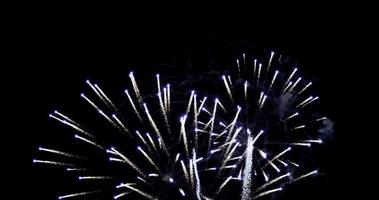 Big group of spectacular fireworks glowing in night sky in 4K slow motion