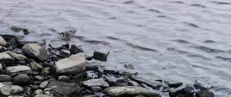 Rippling Water on Shoreline Rocks