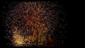 Close up to golden glitter fireworks flasing on anniversary night in 4K