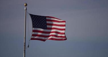 Close up of America flag moving in a clear windy day in 4K