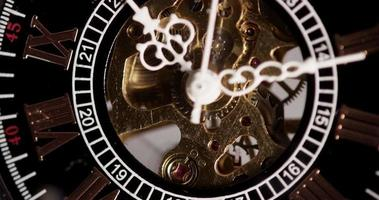 Extreme close up of pocket watch with exposed machinery working from 10:10 to 10:15 in 4K time lapse video