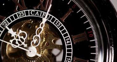 Extreme close up of pocket watch with exposed machinery working for eight minutes in 4K time lapse video