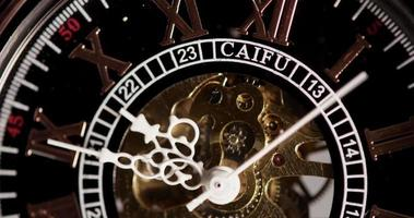 Extreme close up of pocket watch with exposed machinery working from 9:44 to 10:00 in 4K time lapse video