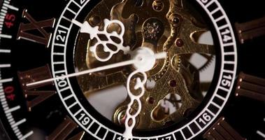Extreme close up of pocket watch with exposed machinery working from 9:30 to 9:42 in 4K time lapse video