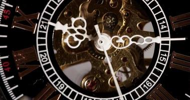 Extreme close up of pocket watch with exposed machinery working from 9:10 to 9:25 in 4K time lapse video