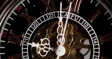 Extreme close up of pocket watch with exposed machinery working from 9:55 to 10:09 in 4K time lapse video