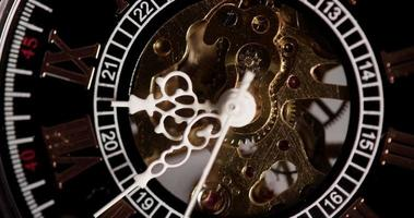 Extreme close up of pocket watch with exposed machinery working from 8:35 to 8:53 in 4K time lapse video