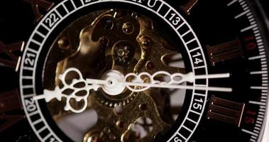 Extreme close up of pocket watch with exposed machinery working from 8:10 to 8:19 in 4K time lapse video