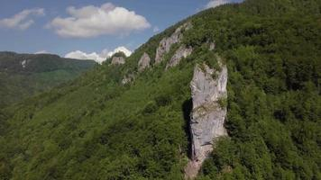 Drone in a valley approaching a rock 4K