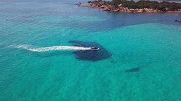 Following a jet ski in the bay in 4K video