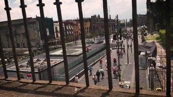Time Lapse Of People And Pyramid Models In The Main Square Of Mexico City Through Railing