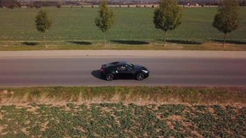 Drone follows a sports car from right and back
