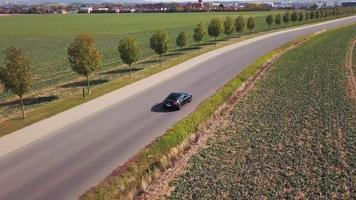 Drone follows a sports car from right back in 4K