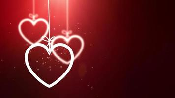 paper valentine hearts falling down hanging on string red background video