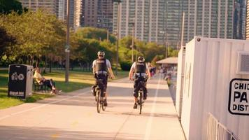 Police Officers On Bike Lane Moving Away