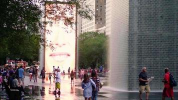 People Walking Next To The Crown Fountain In Chicago