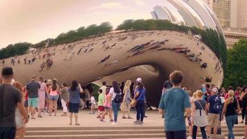 People Walking And Taking Pictures Of The Bean In Chicago