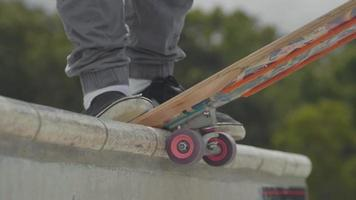Close Up Of Skateboard Wheels And Man Feet Skating
