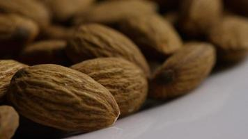 Cinematic, rotating shot of almonds on a white surface - ALMONDS 038