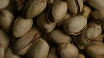 Cinematic, rotating shot of pistachios on a white surface - PISTACHIOS 032