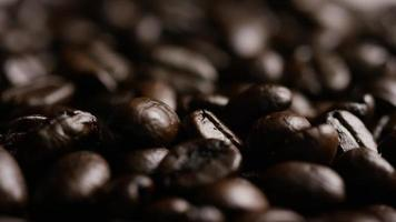 Rotating shot of delicious, roasted coffee beans on a white surface - COFFEE BEANS 079