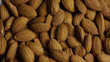 Cinematic, rotating shot of almonds on a white surface - ALMONDS 019