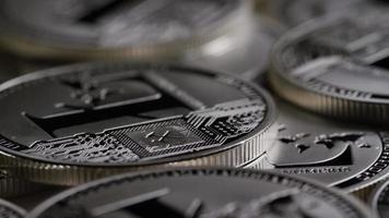 rotierende Aufnahme von Litecoin-Bitcoins (digitale Kryptowährung) - Bitcoin Litecoin 0186
