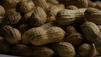 Cinematic, rotating shot of peanuts on a white surface - PEANUTS 030