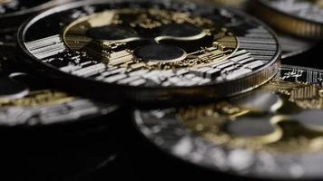 Rotating shot of Bitcoins (digital cryptocurrency) - BITCOIN RIPPLE 0121 video