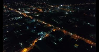 An aerial view flying over a country city in Thailand at night