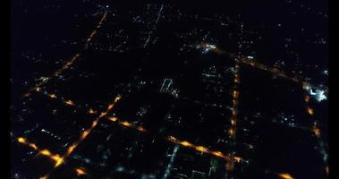 An aerial view flying over a Thailand city at night