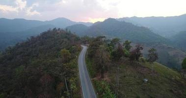 Aerial flythrough of beautiful country road mountains Thailand